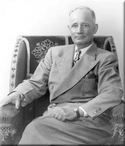 napoleon hill sitting in a wingchair